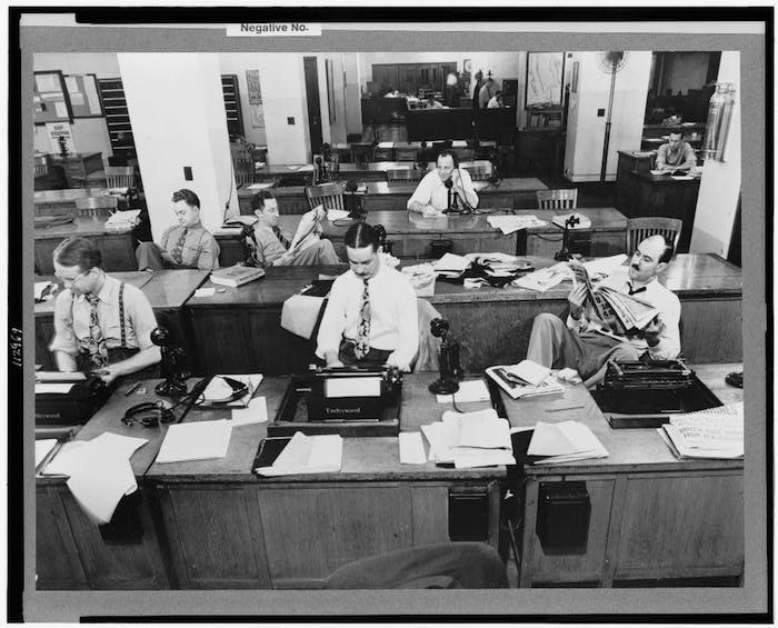 Photo of The New York Times newsroom in 1942 from the Library of Congress.