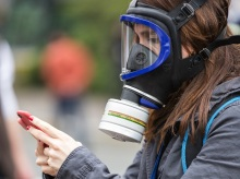 Gas mask, woman journalist