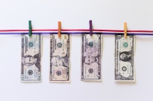 Money clipped to clothespins