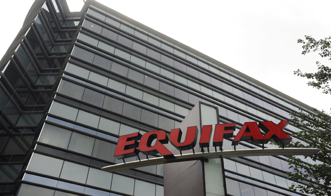 Equifax logo in front of a building
