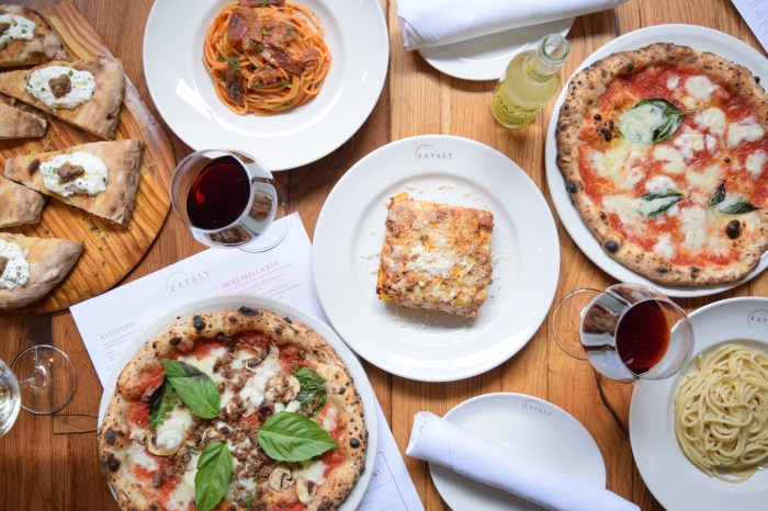 Eataly Las Vegas - table set with Eataly pizzas, pasta, and wine