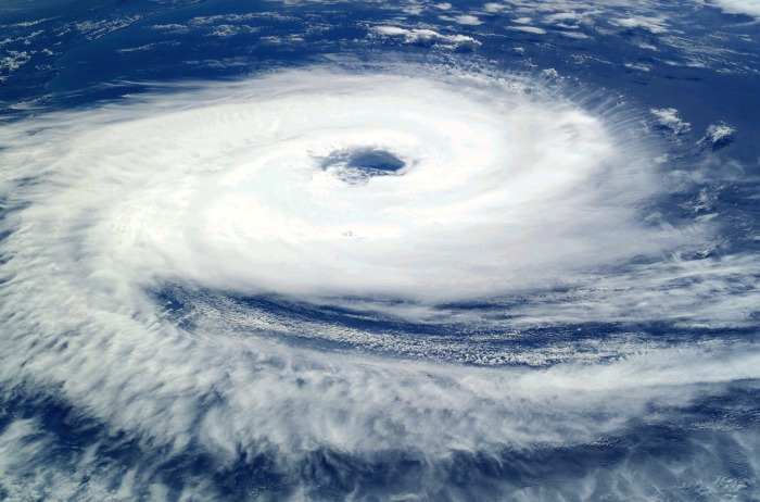Hurricane eye and storm over the water, viewed from above