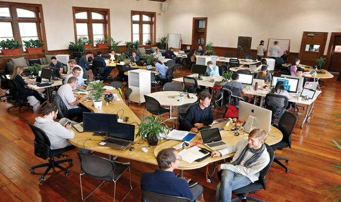 Employees in an open concept workplace
