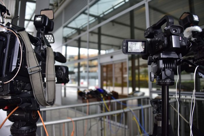 News cameras stationed by interview location