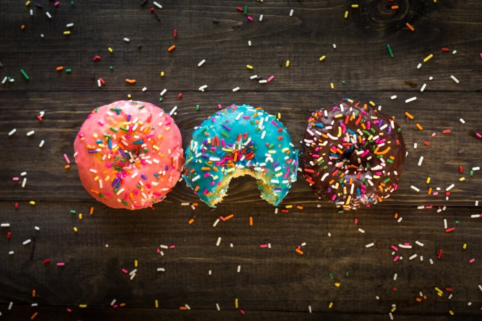 Pink, blue and brown doughnuts with rainbow sprinkles