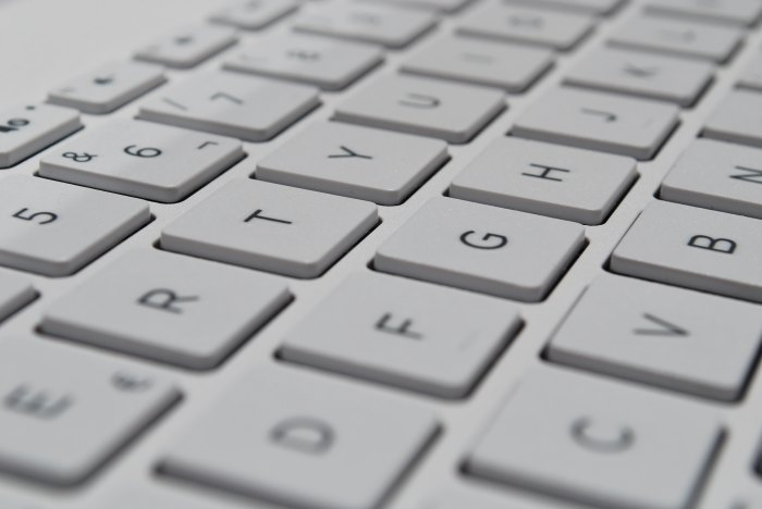 Zoomed in photo of a white keyboard