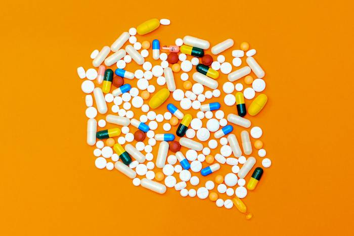 AP Style Reminders - Addiction terms - image of various pills grouped together
