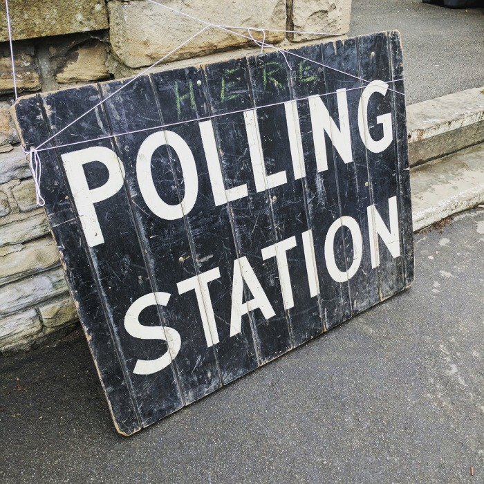 AP Style Rules - polling station sign outside a building