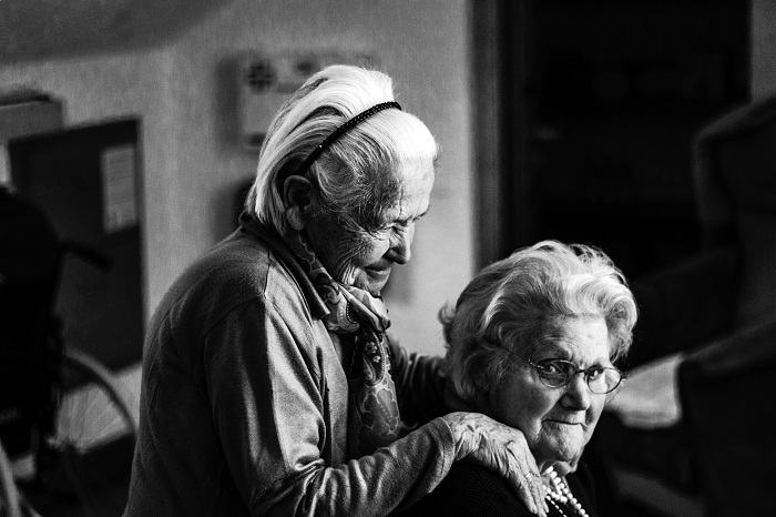 Two elderly women in a retirement home