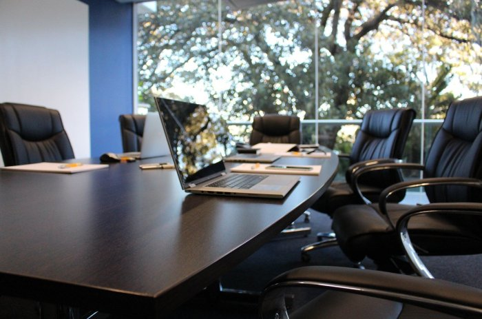 Empty boardroom with laptop on the desk