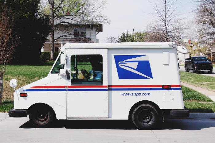 Photo of a U.S. Postal Service truck parked at the curb
