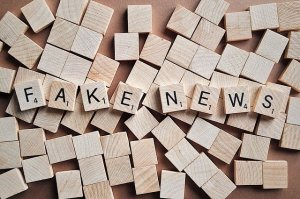 A pile of Scrabble tiles laid out to spell Fake News